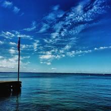 American Flag On Pier At Lake Erie Against Sky