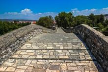 Stone Footbridge Against Sky