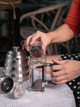 Making Coffee By French Press, Pouring Ground Coffee Into A Glass Jar