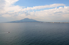 Distant View Of Mount Vesuvius Seen From Sea Against Sky