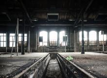 Railroad Tracks In Abandoned Hangar