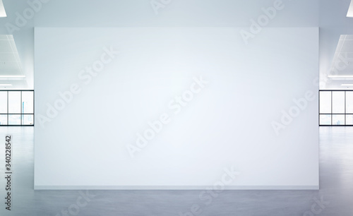 Obraz Blank wall in bright office mockup with large windows and sun passing through 3D rendering - fototapety do salonu