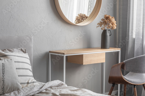 Elegant Round Mirror In Wooden Frame Above Fancy Console Table With Flowers In Vase In Trendy Bedroom Interior With Beige Vase Buy This Stock Photo And Explore Similar Images At Adobe