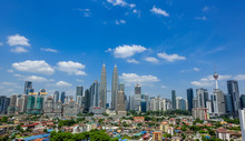 Petronas Towers Amidst Modern Buildings In City
