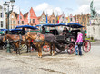 canvas print picture - Famous old colorful buildings at Market square in Bruges, Belgium. Popular Flemish city with almost intact medieval architecture.