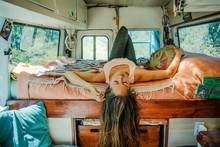 Girl Laying On A Bed In A Camper Van