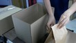 Prepare the products into the box for e-commerce online shopping delivery.