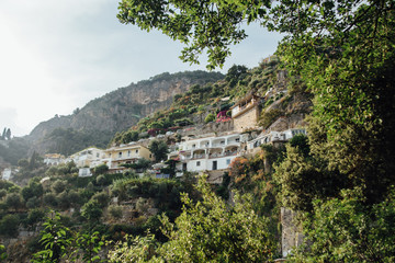 Fototapeta na wymiar Houses and hotels are built on rocks in Positano and Italy