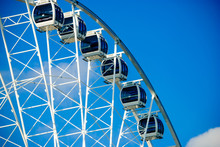 Cars On A Large Ferris Wheel A...