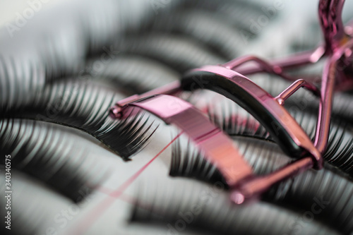 Fotografia, Obraz Set of false eyelashes in a box with Curling tweezers: close-up, extra macro, ba