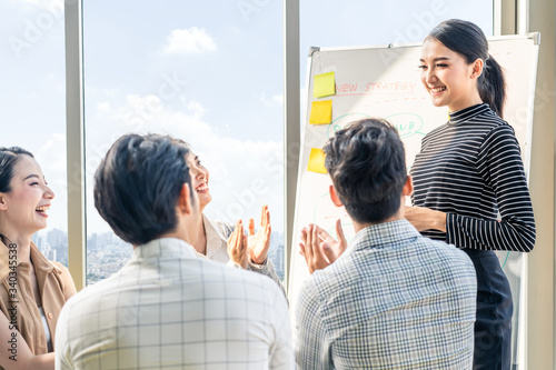Asian smart woman present work and got praise and complement from team colleague Canvas Print