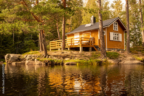 Canvas Print Off-grid Norwegian cabin in the woods powered by solar energy