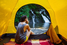 Woman Sitting In Yellow Tent L...