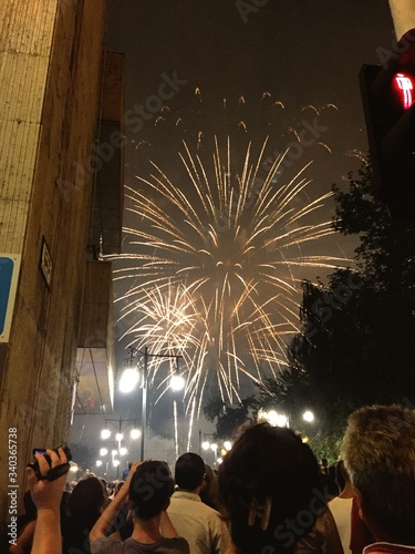 Low Angle View Of People Looking At Firework Display Against Sky #340365738