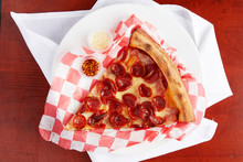 A Classic Triangle New York Style Slice Of Pepperoni Pizza