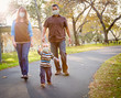 canvas print picture - Happy Mixed Race Ethnic Family Walking In The Park Wearing Medical Face Mask