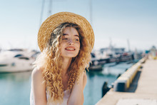 Curly Blonde In A Straw Hat Si...