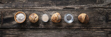 Home Made Bread Buns And Sourdough Yeast Placed On Rustic Wooden Desk