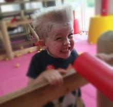 Playful Boy Clenching Teeth At Jungle Gym