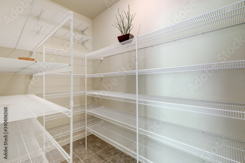 Fototapeta Empty large pantry interior with lots of shelves. obraz
