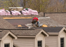 Roofing Contractor Removing Th...