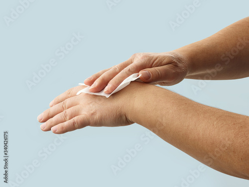 Fototapety, obrazy: hands are cleaned with a disinfectant wipe