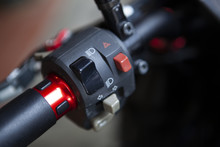 Macro Detail Of Light And Horn Switches In A Naked Motorcycle
