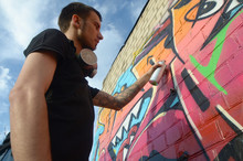 Young Graffiti Artist With Bac...