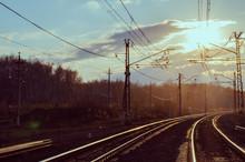 Railroad Tracks At Sunset. Vanishing Point.