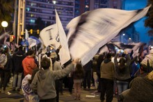 Protestors Protesting In City At Dusk