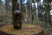 Close-up Of Bottle Against Trees