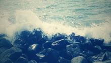 Aerial View Of Waves Splashing On Shore