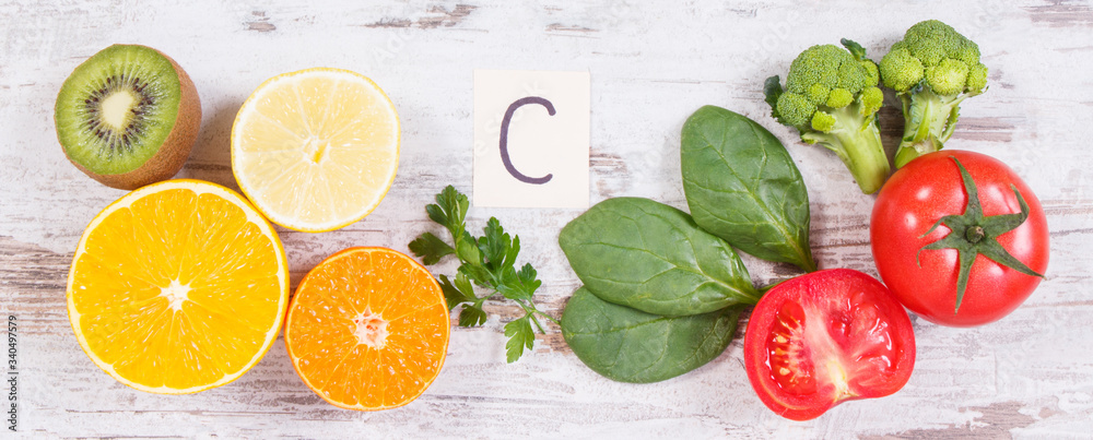 Fototapeta Fruits and vegetables as sources vitamin C, dietary fiber and minerals, strengthening immunity concept