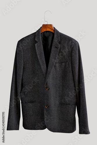 Gray blazer on a hanger Canvas Print