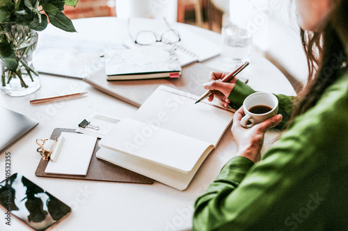 Valokuva Woman writing in a journal