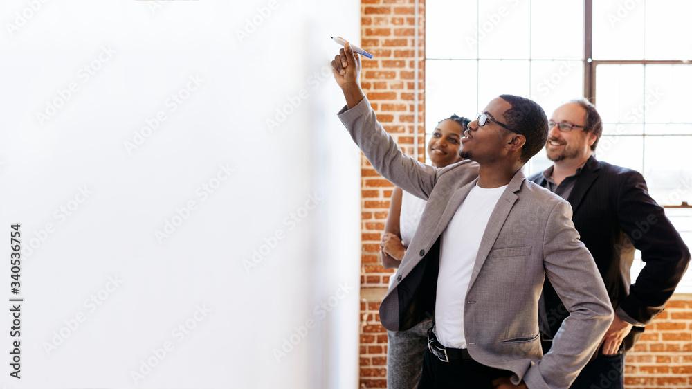 Fototapeta Team writing on a board