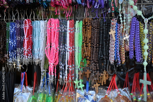 Fototapeta Multi Colored Rosary Beads And Bracelets Hanging In Store For Sale At Market Sta
