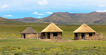 Traditional Rural Round Huts In A Lesotho Village In The Countryside Near Sani Pass Road,  Basotho Drakensberg