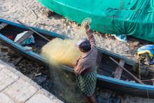 Kochi, Kerala - December 30, 2019: Fisherman Mending His Nets In Fort Kochi, Kerala India