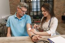 Nurse Injecting With Syringe T...
