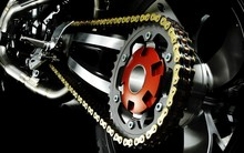Close-up Of Motorcycle Chain Against Black Background