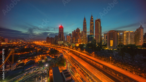 Fototapety, obrazy: Aerial View Of City Lit Up At Night