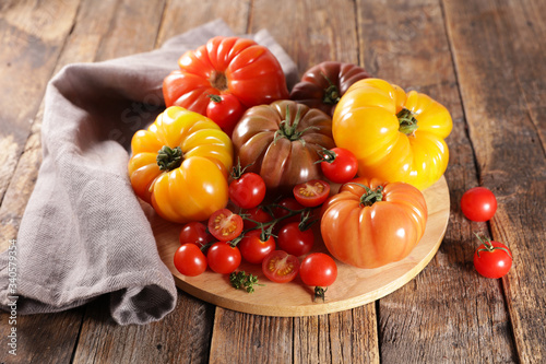 Leinwand Poster variety of colorful tomatoes on wood background