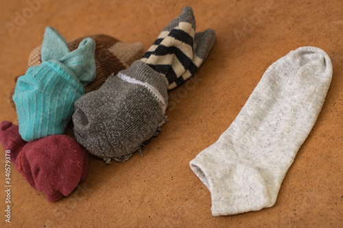 Vászonkép Photo with socks arranged in pairs after washing and one toe without a pair