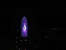 Illuminated Purple Ferris Wheel At Night
