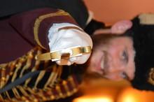 Portrait Of Smiling British Royal Guard Holding Sword