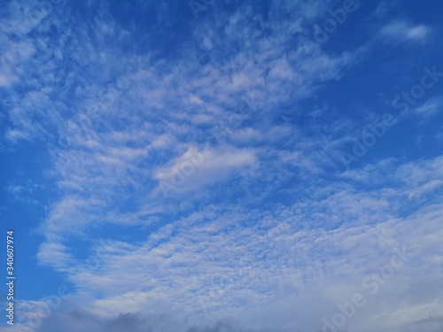 Altostratus white clouds in the blue sky natural background beautiful nature env Wallpaper Mural