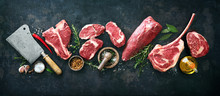Variety Of Raw Beef Meat Steaks For Grilling With Seasoning And Utensils