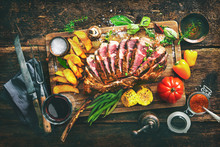 Grilled Meat, Sliced tomahawk Beef Steak With Spices, French Fries And Vegetables