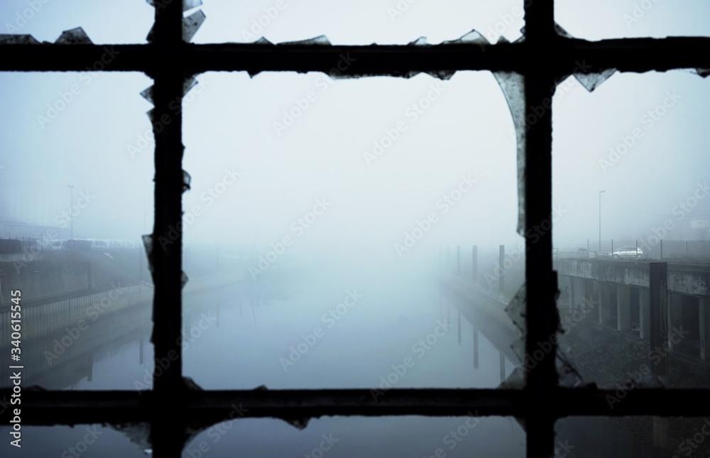 Obraz Calm Lake During Foggy Weather Seen Through Broken Window fototapeta, plakat